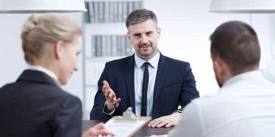 Handsome man convincing examination board members to hire him
