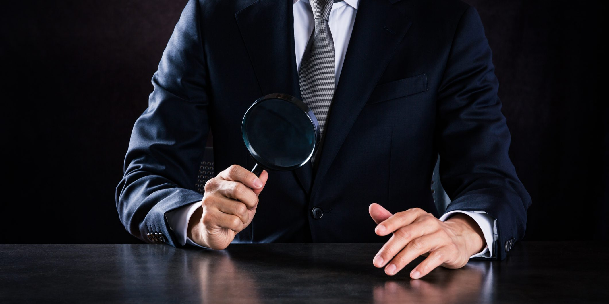 This is a photograph of Businessman with a magnifying glass
